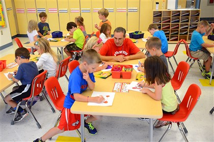 20140829lfSchoolNorth02-1 Kindergarten teacher Jeff Dzubinski watches as his students color at Avonworth Primary Center on Friday.