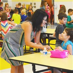 20140829lfSchoolNorth01 First-grade teacher Suzanne DiSanzo helps Madelyn Hanlon, 6, to unpack her lunch at Avonworth Primary Center Friday.