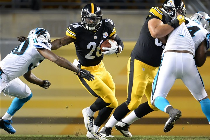 20140828pdSteelersSports11-4 Le'Veon Bell runs in the Steelers final preseason game on Thursday.