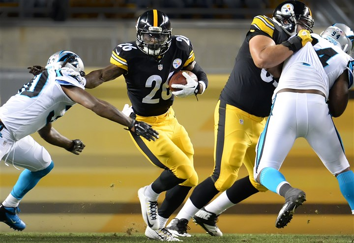 20140828pdSteelersSports11-4 Steelers' Le'Veon Bell picks up three yards against the Carolina Panthers at Heinz Field Thursday night. The Steelers lost, 10-0.