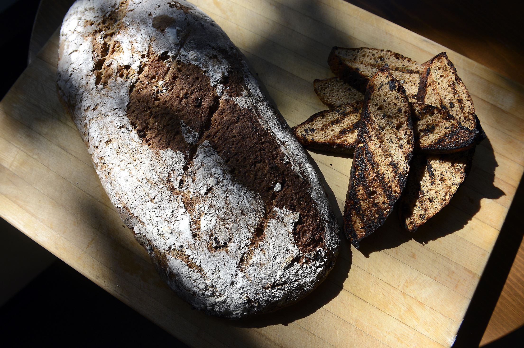 20140828bwWheatFood01 Whole wheat olive bread made from organic whole wheat bread flour from the Weatherbury Farm in Avella. Made at The Porch at Schenley by Kevin Hermann, Executive Chef. FOOD story by virginia phillips