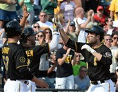 Pirates' Neil Walker, right, is congratulated by his teammates after hitting a three-run homer in the first inning against the Cincinnati Reds at PNC Park this afternoon. The Pirates won, 3-2.