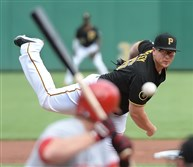 Pirates' starter Vance Worley delivers against the Cincinnati Reds at PNC Park today. The Pirates won, 3-2.