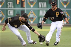 Neil walker and right fielder Andrew Lambo misplay the ball hit by Reds Zack Cozart for a single Saturday at PNC Park.
