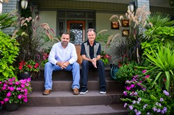Kevin Prall, left, and Layne Bennett on the front steps of the home they purchased in 2011.
