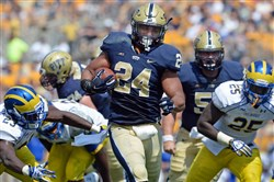 Pitt's James Conner heads toward the end zone for a touchdown against Delaware Saturday afternoon.