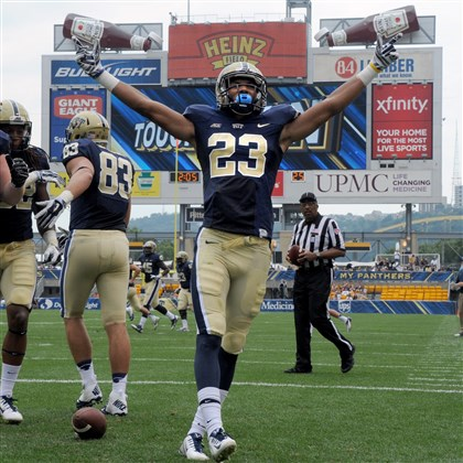 Tyler Boyd Pitt's Tyler Boyd celebrates his touchdown against Delaware's C.J. Jones in the first quarter at Heinz Field Saturday afternoon.