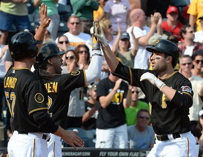 20140830pdPiratesSports01 Pirates' Neil Walker, right, is congratulated by his teammates after hitting a three-run homer in the first inning against the Cincinnati Reds at PNC Park this afternoon. The Pirates won, 3-2.