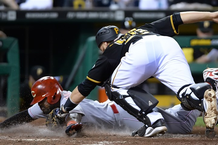 20140829pdPiratesSports06-2 Pirates catcher Russell Martin tags out the Reds' Brandon Phillips at PNC Park.