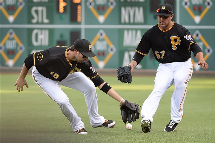 20140830pdPiratesSports03-2 Pirates' Neil Walker and right fielder Andrew Lambo misplay the ball hit by Reds' Zack Cozart for a single at PNC Park today.