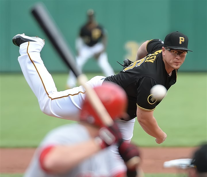 20140830pdPiratesSports02-1 Pirates' starter Vance Worley delivers against the Cincinnati Reds at PNC Park today. The Pirates won, 3-2.