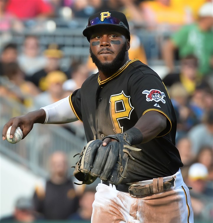 20140830pdPiratesSports04-3 Pirates' Josh Harrison throws out Reds' Brandon Phillips at PNC Park in today's game.