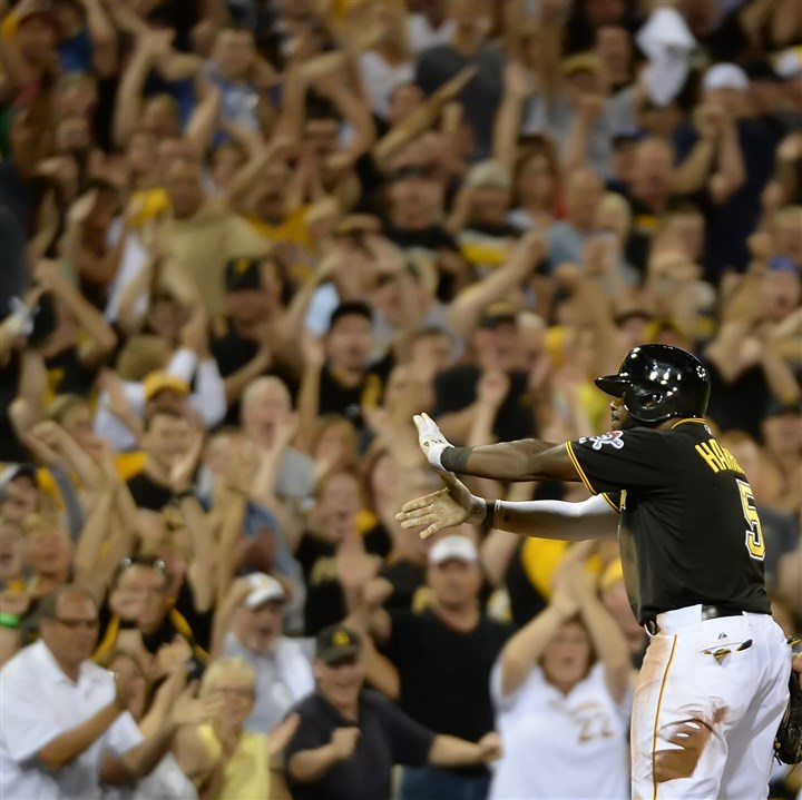 20140829pdPiratesSports08-1 The Pittsburgh Pirates' Josh Harrison celebrates after hitting a triple against the Reds at PNC Park.
