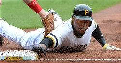 Starling Marte just gets under the tag of the Reds' first baseman Todd Frazier.