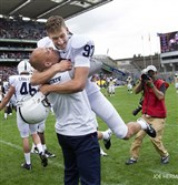 First-year Penn State coach James Franklin lifts kicker Sam Ficken after Ficken's field goal on the last play of the game beat Central Florida, 26-24, Saturday at Croke Park In Dublin.