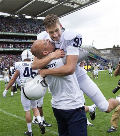 PennState Ireland08302014 First-year Penn State coach James Franklin lifts kicker Sam Ficken after Ficken's field goal on the last play of the game beat Central Florida, 26-24, Saturday at Croke Park In Dublin.