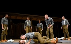 "Nat McIlwaine (Tony Bingham) pins Martin Crawford (Dylan Marquis Meyers) as George Anderson (Jonathan Visser) incites them in PICT Classical Theatre's ""Observe the Sons of Ulster Marching Towards the Somme."""