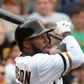 Josh Harrison singles Sunday against the Reds at PNC Park.