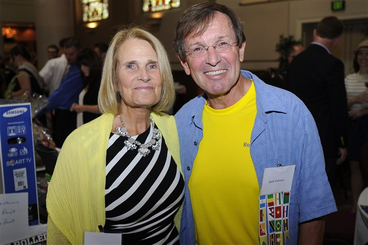 20140831CMLemonAIDSeen011-10 Dr. Jack Demos, founder of Surgicorps, poses with his wife, Cathy, at the LemonAID for Surgicorps event at The Priory Hotel on the North Side. The benefit was paid for by Phil Laboon, CEO of Eyeflow.