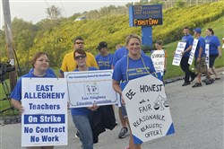 Teachers, parents and students march in September at the entry to the East Allegheny school campus on Jacks Run Road. Teachers were on strike for 16 days earlier this school year.