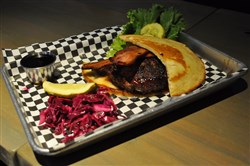 The Maple Bacon Waffle Burger with house-pickled purple cabbage at Gus's Cafe in Lawrenceville.