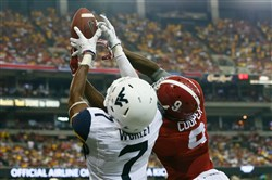 West Virginia's Daryl Worley breaks up a pass intended for Alabama's Amari Cooper at the Georgia Dome on Aug. 30, 2014.