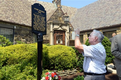20140826RARlocalmansion1 Phil Stebler, of Cranberry, takes a picture of the commemorative marker for the Stone Mansion.
