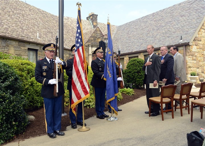 20140826RARlocalmansion4-3 The color guard from 2754 VFW in West View stand as the Pledge of Allegiance is said during the dedication of the commemorative marker at the Stone Mansion along Route 910 in Franklin Park. The marker is one of two for the mansion, which is now the Schellhaas & Son Funeral Home.