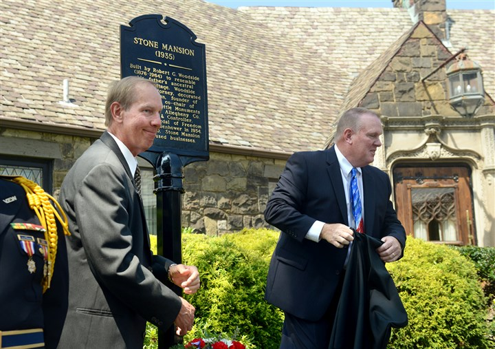 20140826RARlocalmansion2-1 Chuck, left, and Rob Schellhaas unveil the commemorative marker for the Stone Mansion in Franklin Park. The mansion is now the Schellhaas & Son Funeral Home.