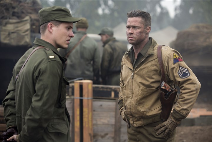 "preview_fury Wardaddy (Brad Pitt) gets his new orders from Lieutenant Parker (Xavier Samuel) in ""Fury."""