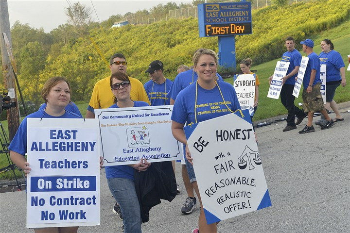 East Allegheny teacher strike East Allegheny teachers, joined by some parents and students, walk the picket line at the entrance to the East Allegheny school campus on Jacks Run Road, home to the high school and Logan Middle School.