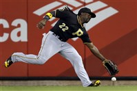 Andrew McCutchen has trouble reaching a double by the St. Louis Cardinals' Jhonny Peralta during the seventh inning tonight in St. Louis. Peralta scored on a wild pitch later in the inning.
