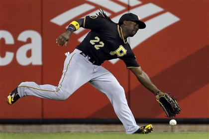 Andrew McCutchen has trouble reaching a double by the St. Louis Cardinals' Jhonny Peralta during the seventh inning Tuesday in St. Louis. Peralta scored on a wild pitch later in the inning.