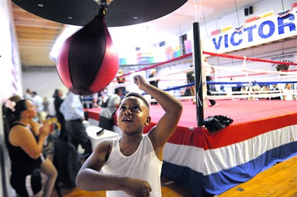 Hill District boxing ring Isaiah Dolby, 7, hits the speed bag Wednesday during the dedication and ribbon-cutting for the 11,000-square-foot boxing gym at the Centre Avenue YMCA.