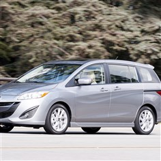 2014Mazda5ext The small 2014 Mazda5 microvan looks as sporty as ever from the outside.