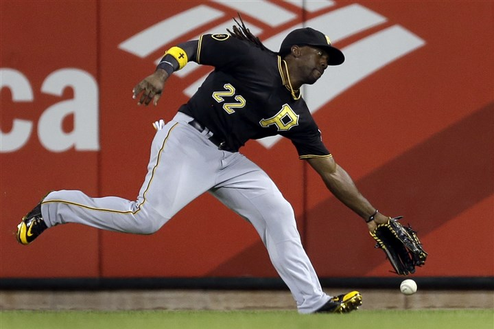 pirates819 Andrew McCutchen has trouble reaching a double by the St. Louis Cardinals' Jhonny Peralta during the seventh inning Tuesday in St. Louis. Peralta scored on a wild pitch later in the inning.