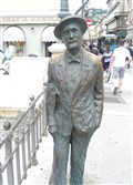 The 10-year-old statue of James Joyce with its shiny left shoulder on the Grand Canal in Trieste.