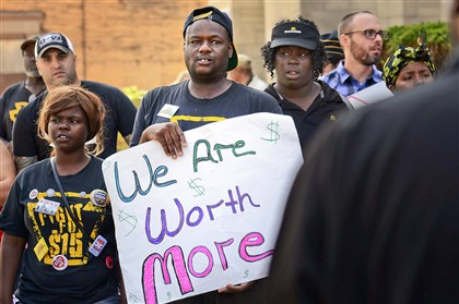 20140904jrMinimumBiz2-1 Fred Connor joins other minimum wage earners in a protest today in Wilkinsburg.