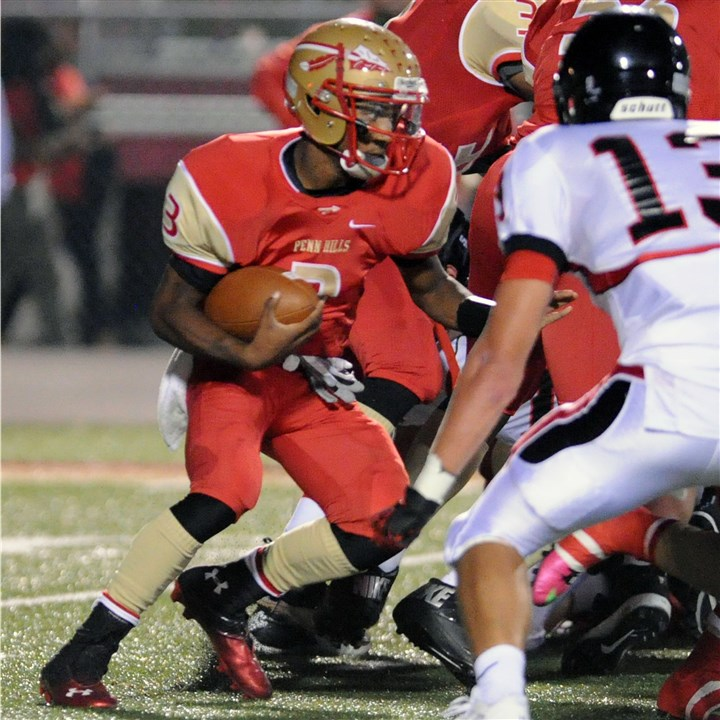 9jw00k4d.jpg Penn Hills quarterback Bill Kisner runs against Upper St. Clair last week.