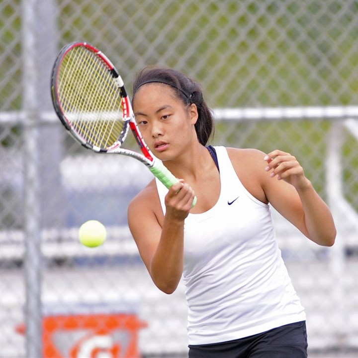 20140827CMNATennisSports003.jpg North Allegheny's No. 1 singles player, Anna Li, returns a shot during a match against Hampton.