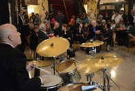 "Andy Reamer, a member of the White Tie Group, a jazz ensemble made up of symphony musicians, plays the drums during a Pittsburgh Symphony Orchestra ""happy hour"" in May in the lobby of Heinz Hall."