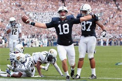 Penn State Nittany Lions tight end Jesse James celebrates after scoring a touchdown during the third quarter against the Akron Zips at Beaver Stadium on Sep 6, 2014. Penn State defeated Akron 21-3.