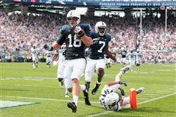 Penn State Nittany Lions tight end Jesse James runs the ball into the end zone for a touchdown during the fourth quarter against the Akron Zips at Beaver Stadium on Sept. 6, 2014. Penn State defeated Akron 21-3.