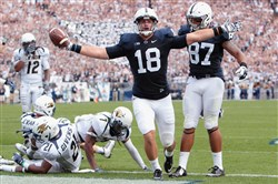 Jesse James celebrates after scoring a touchdown against Akron in September.