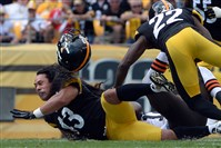 Steelers' Troy Polamalu loses his helmet after taking down Browns' Andrew Hawkins in the third quarter at Heinz Field Sunday afternoon, September 7, 2014.