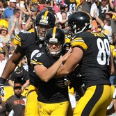 Steelers kicker Shaun Suisham is mobbed by teammates after kicking the game winner in the 2014 season opener against the Cleveland Browns at Heinz Field.