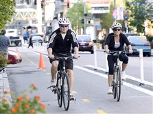Bicyclists, shown riding along the bike lanes on Penn Ave., may not be riding along the Fort Pitt Boulevard in the future.