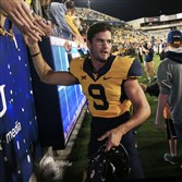 West Virginia quarterback Clint Trickett shakes hands with fans following a 54-0 win Sept. 6 against Towson in Morgantown, W.Va.