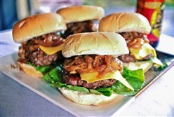 Steakhouse Smoky Barbecue Beer Burgers with Caramelized Beer Onions.