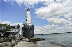 In June, volunteers from New England Regional Council of Carpenters erected scaffolding, launching the first phase of the restoration that will include cleaning, re-pointing and repainting of the exterior of the historic 1801 New London Ledge Lighthouse lighthouse.